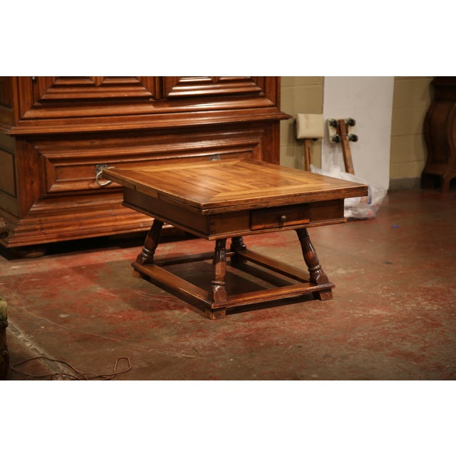 Rustic antique fruit wood coffee table from Eastern France; crafted circa 1780, the cocktail table features a parquetry...