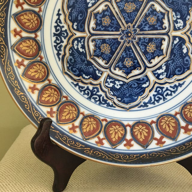 A colorful and intricate Japanese Imari porcelain plate with harmonious geometric design. Hand painted with great...