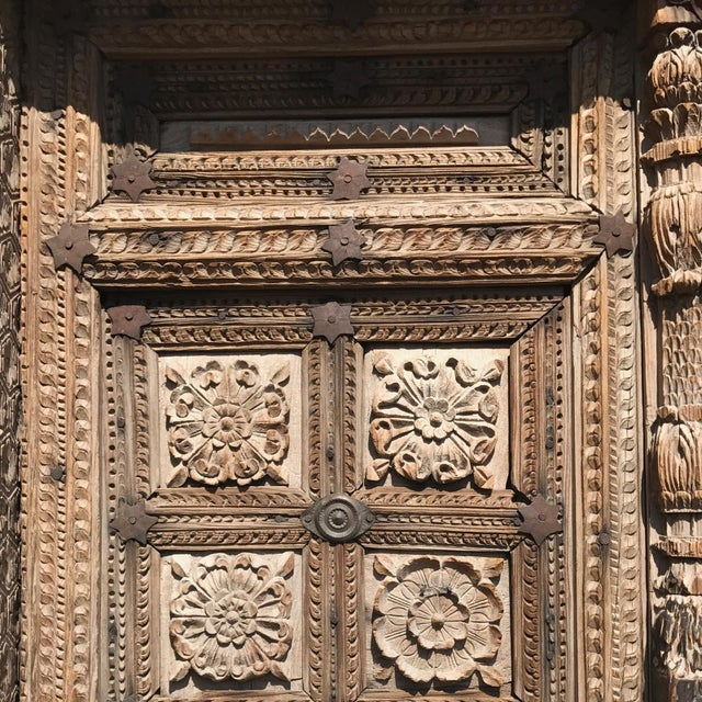 Hand carved exquisite door way with surround from North India. Sun bleached original patina. Circa 1800s.