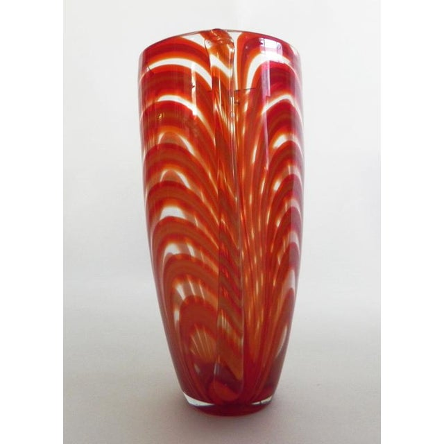 Artful hand blown clear glass vase infused with orange ribbons makes a statement by itself or as a modern backdrop for a...
