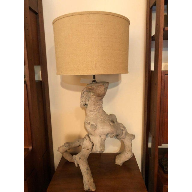 Mid-century driftwood lamp with original drum shade. This came out of the illustration artist Victor Olson's home in...