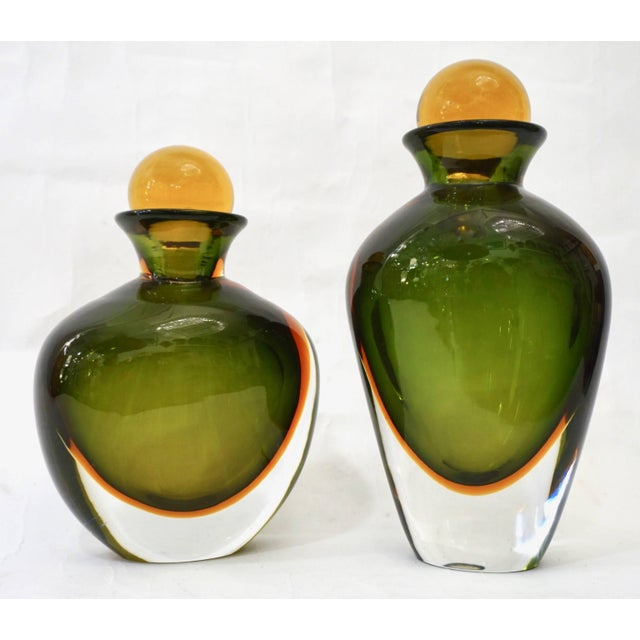 1980s rare Italian set of two ovoid shape bottles with yellow solid stoppers in Murano glass by Formia, beautiful and...