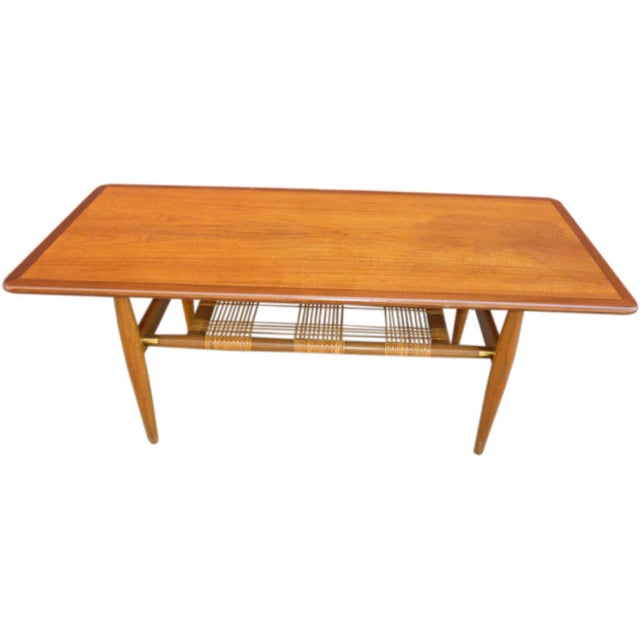 Coffee table in teak, oak and cane possibly designed by Hans Wegner and produced by Andr. Tuck. Period 1960's Very good...