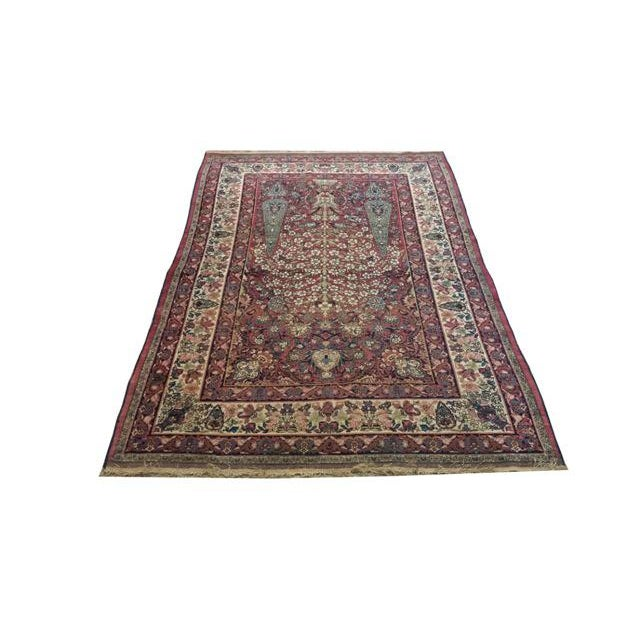 Infuse a touch of beauty to your home with this beautiful handmade wool Antique Kerman rug.