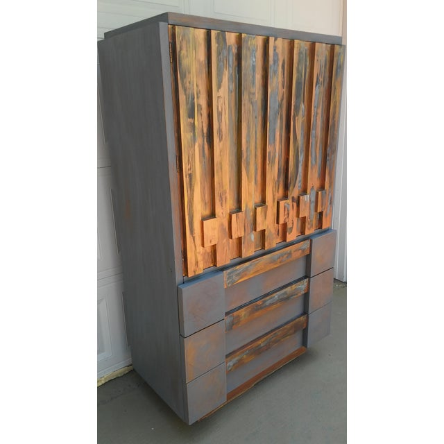 This gorgeous mid-century modern brutalist tall dresser was made by Lane in the style of designer Paul Evans. It has been...