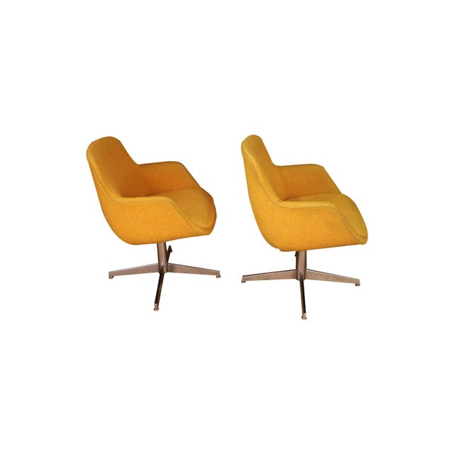 Vibrant pair of Swivel Barrel chairs manufactured by Steelcase, circa 1970s. Feature original striking yellow/gold...