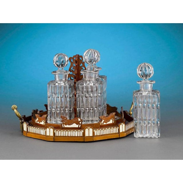 This striking and rare Napoleon III-period cave à liqueur is masterfully modeled to represent the Cirque d'Hiver, or...