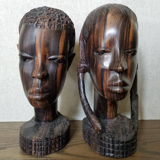 Vintage 1960's African male & female busts made of Zebra wood. The busts are gallery pieces and much higher quality than...
