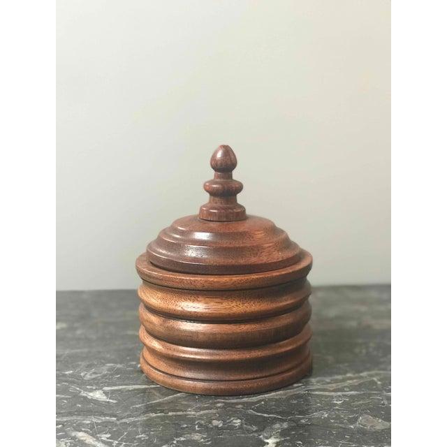Wooden tobacco jar from 1920s Belgium.