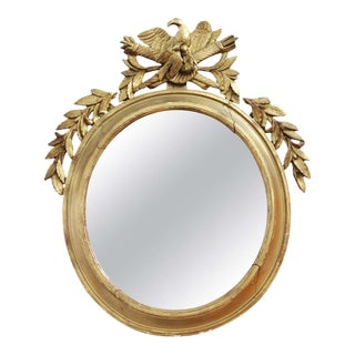 Neoclassical Revival Oblong Giltwood Mirror With Eagle and Trophies For Sale