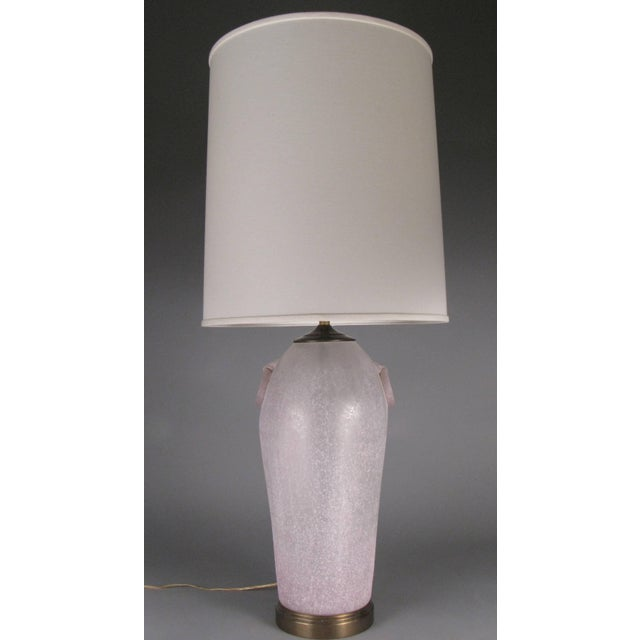A pair of large-scale vintage 1970s Etruscan style glass lamps by Chapman, with a light pink/lavender dappled matte...