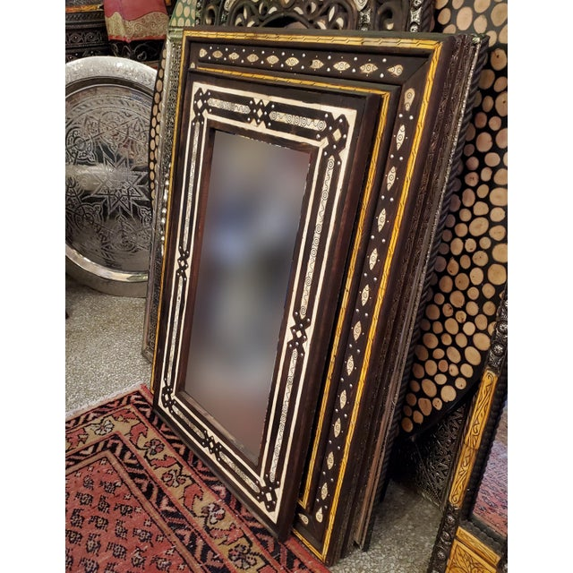 "Medium size metal inlay Moroccan mirror. Made in the city of Marrakech. Rectangular shape, measuring approximately 32"" x..."