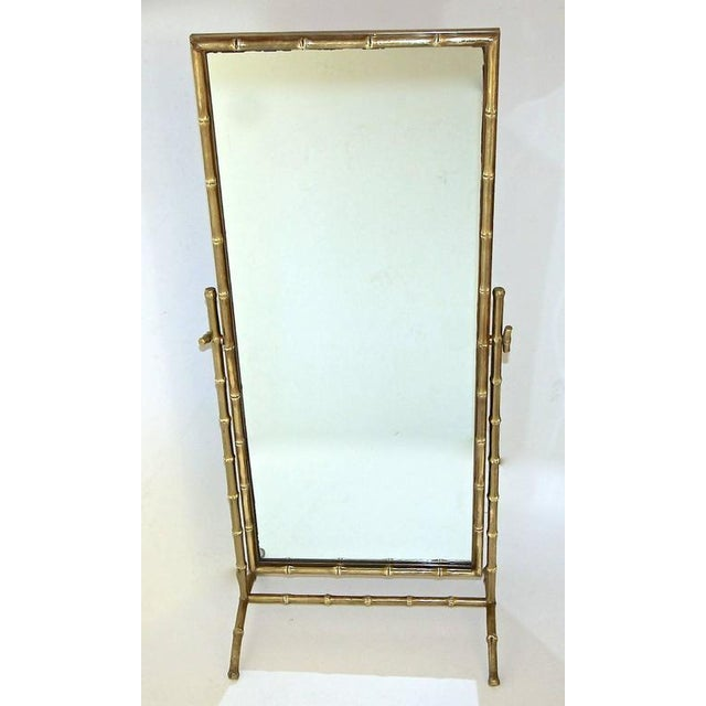 Rare French faux bronze bamboo cheval floor or dresser mirror, attributed to Maison Bagues. Framed mirror pivots with...