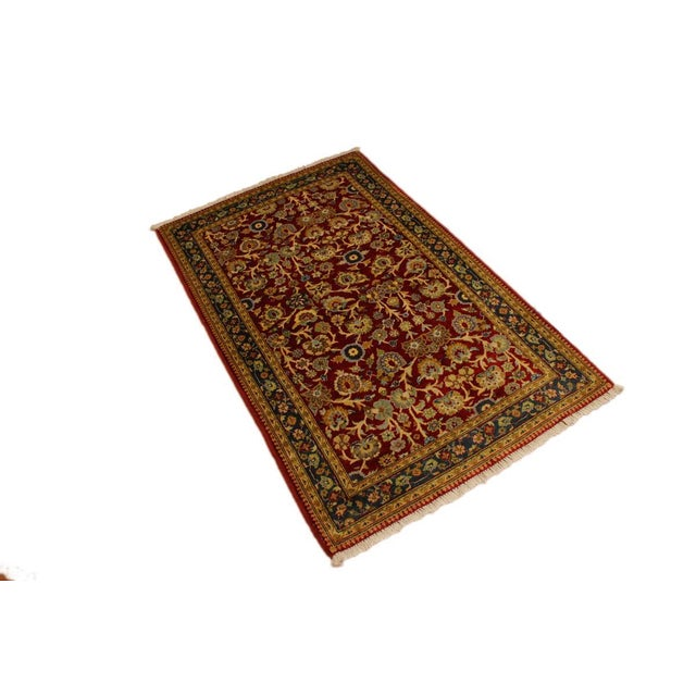 Designed with a mesmerizing intricate traditional motif this glorious hand knotted rug is a masterpiece that will fill any...