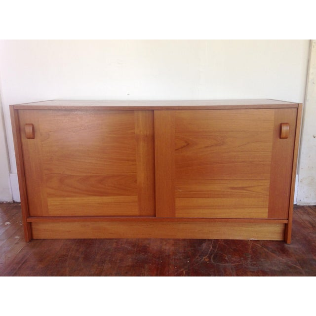 Vintage mid century modern Danish teak credenza/sideboard with 2 sliding doors and shelves by Domino Mobler of Denmark....