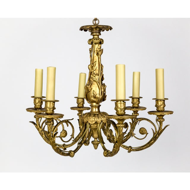An Art Nouveau, gilded bronze chandelier with beautifully cast ladybugs, flora scrolls, foliage, and Neoclassical acanthus...