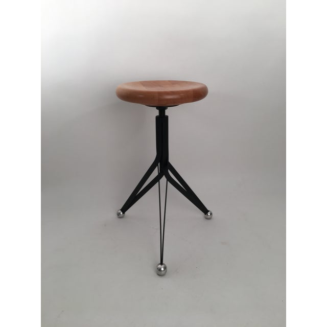 Bar Stool designed by Ron Arad for Zeus, 1994. Wood top, adjustable.