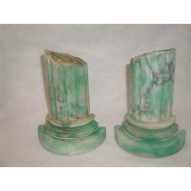 Pair of handsome green marble bookends from Italy 20th century. Beautiful coloring in the mottled green and cream shading...