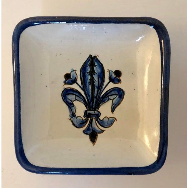 Pair of vintage fleur de lis Italian pottery ashtrays or small trinket dishes.