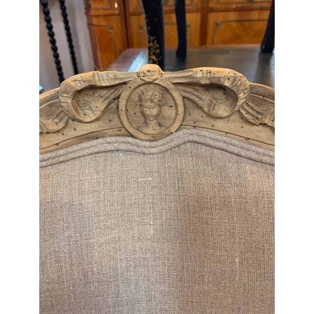Beautiful set of 4 hand carved bleached walnut armchairs. The chairs are upholstered in taupe linen. Each chair has...