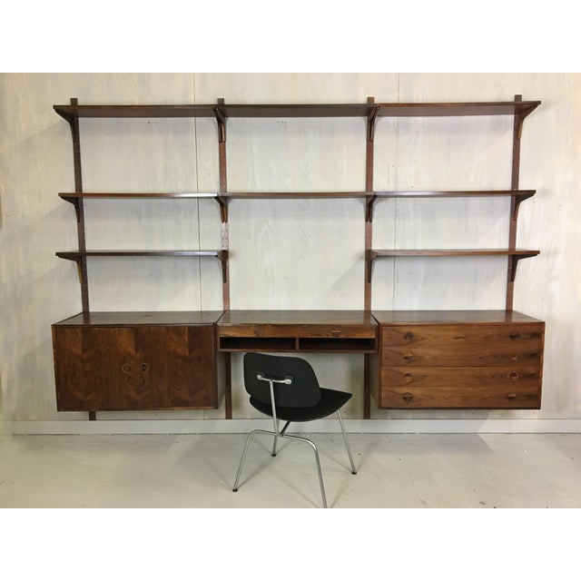 """Rare rosewood veneer wall unit featuring the HG stamp and marked """"Made in Denmark,"""" circa 1960's. Features sculptural..."""