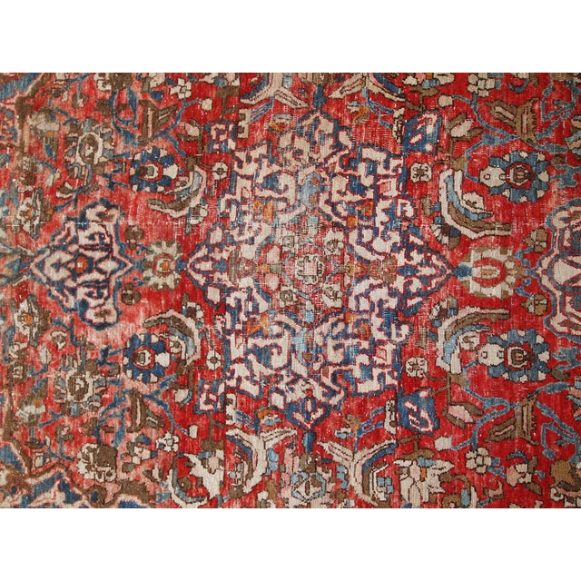 Handmade antique Persian Mahal rug in distressed condition. The rug is from the beginning of 20th century made in red and...