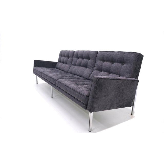 Florence Knoll parallel bar sofa with arms. Restored and upholstered a charcoal / medium to dark gray with just a hint of...