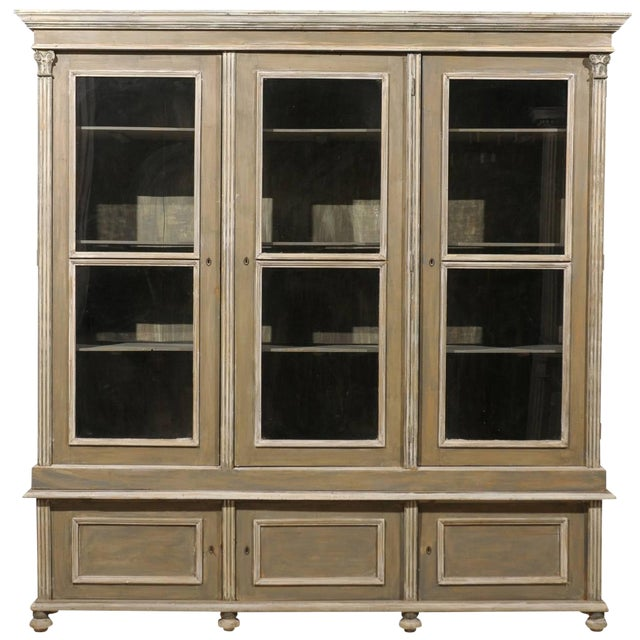 French 19th Century Wood Cabinet With Three Glass Doors Raised on Round Feet For Sale