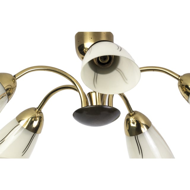 This beautiful Mid-Century Modernist chandelier features a spider form design brass frame with (5) conical glass shades...