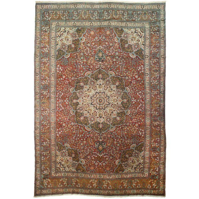 Antique Persian Marand Rug in a traditional style. The red and green colors add a subtle but bold statement. Measurement:...