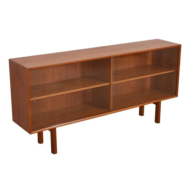 Wonderful Danish Modern display cabinet in teak with sliding glass doors. Shelves are adjustable. Use it on its own or...