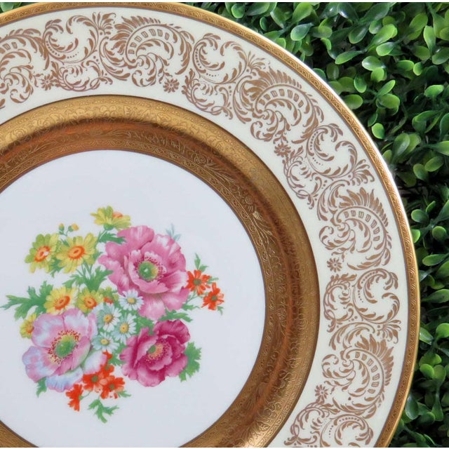 Vintage Wheeling Decorating Co dinner plate. Pattern features heavy gold on the rim edge and the verge with a pretty...