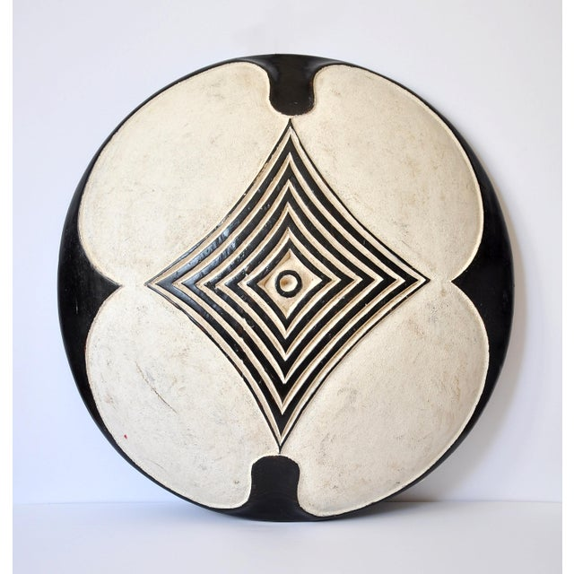 This is a beautiful vintage Zulu shield that comes from Congo, Africa. The front features a wonderful design filled with...