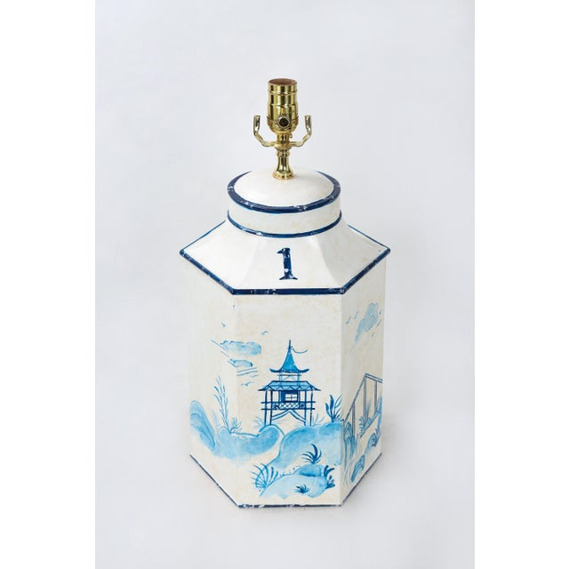 This vintage blue and white tole Hexagon tea caddy lamp depicts pavilions and cranes in an oriental landscape. No.1 pairs...