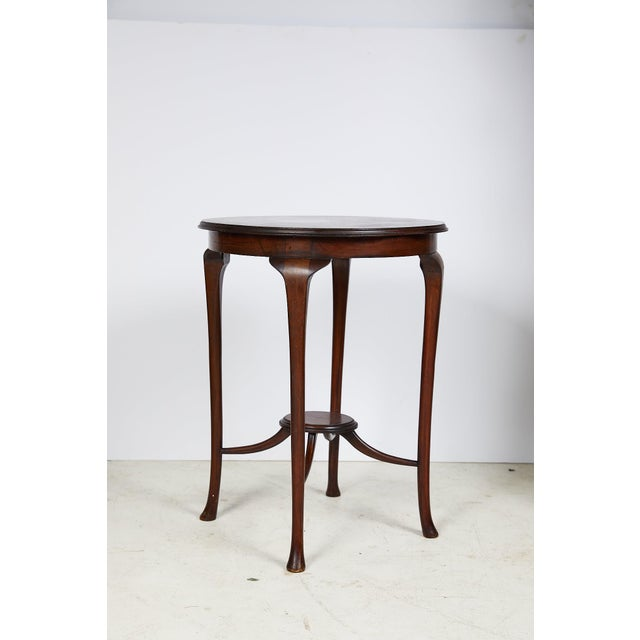 Early 20th century elegant English tea or side table made of mahogany during the Art Nouveau period. The upper surface,...