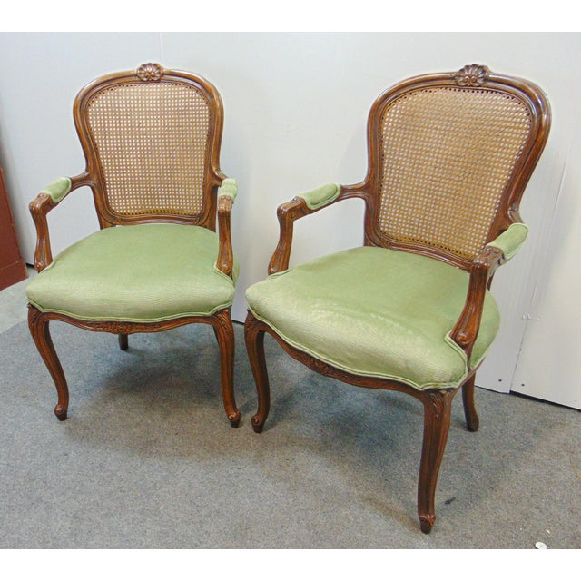 A pair of Louis XV style arm chairs by Drexel . Made of solid Fruitwood, shell carved accent on crest , caned back , green...