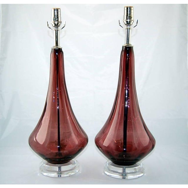 Matched pair of Petticoat lamps in AMETHYST CASIS. These Venetian glass table lamps have large controlled bubbles. The...