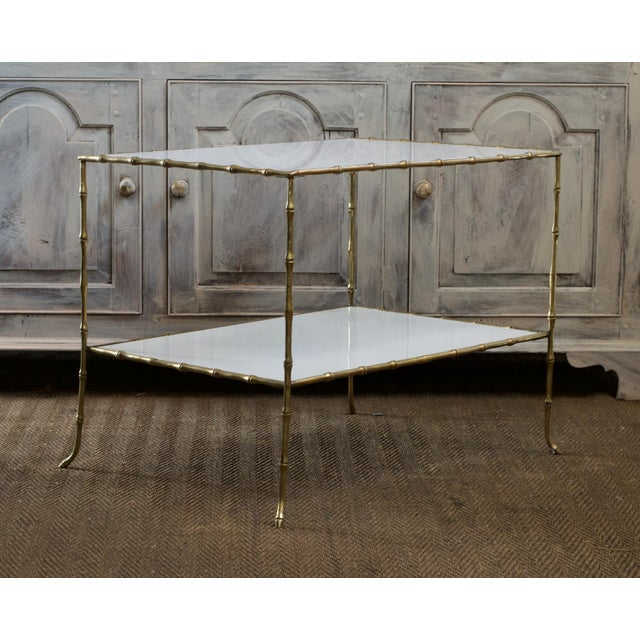 Faux bamboo side table or smaller scale coffee table in the manner of esteemed French Atelier Maison Bagues. The circa...