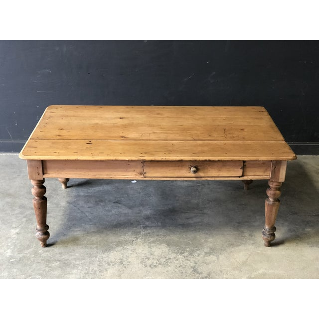 This sturdy antique french farm table is just the right size featuring gorgeous patina to wood, pull out drawer and...