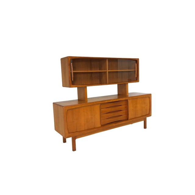 Amazing Mid Century Modern Danish Modern Teak credenza/sideboard and china cabinet and display made in Denmark. These two...