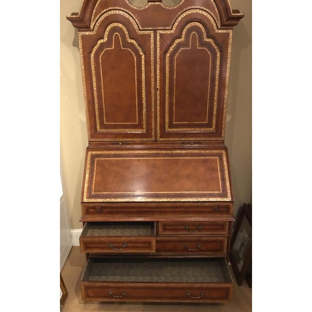 Elegant Maitland Smith traditional tooled leather secretary desk, four lower drawers lined in decorative paper, two doors...
