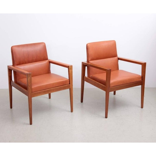 Fantastic set of ten Jens Risom Armchairs in american walnut from the 1960s. Four have leather on the armrests. The chairs...