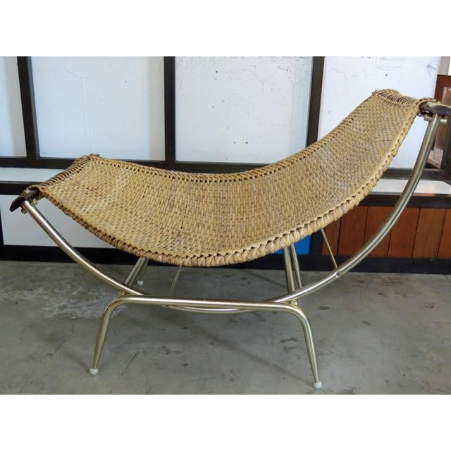 What a find and particularly in such good condition! This mid-century modern rattan or wicker basket lounge chair is by...