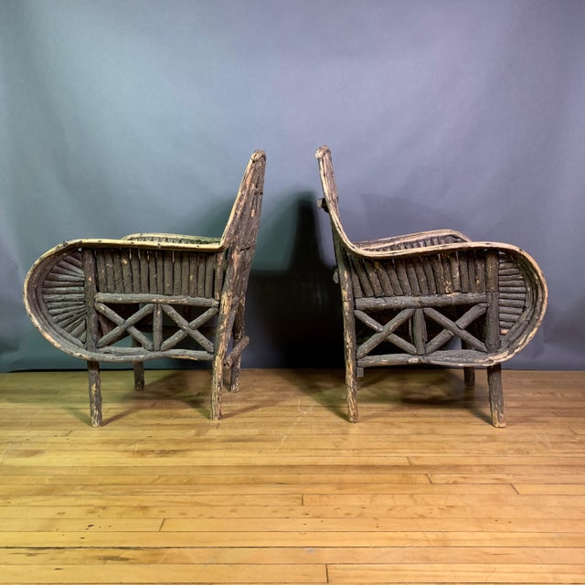 A unique pair of Adirondack chairs from 1930s made in New Hampshire - very good condition. Well constructed with multiple...