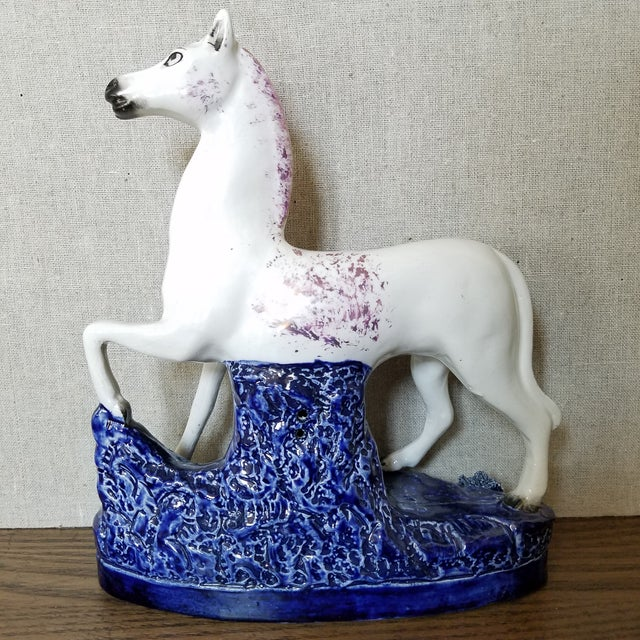 Vintage Staffordshire white horse with hand brushed lavender and black accents and a cobalt base with a gold ring. A truly...