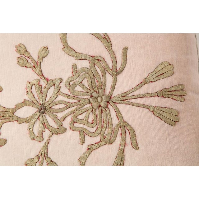 A lovely cushion from B. Viz design crafted on antique Ottoman Empire metallic embroidery on blush pink velvet; hand...