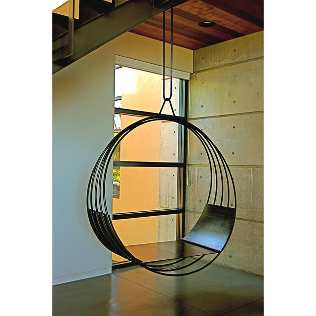 """Custom swing chair by Erin Martin. Clear powder-coat steel hung from 3/4"""" natural fiber rope. 20ft rope doubled over for..."""