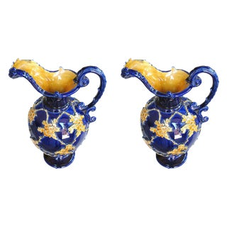 A Pair of Italian Cobalt Glazed Majolica Ewers With Raised Decoration For Sale