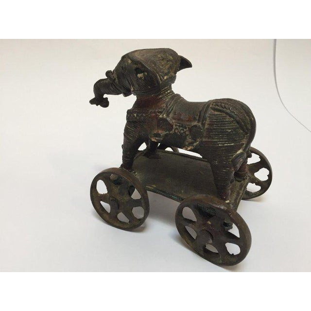 Antique cast bronze elephant temple toy on wheels from India. This beautifully patinated brass temple elephant on wheels...