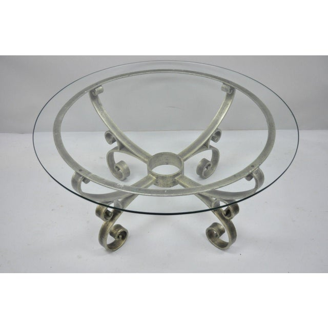 Item features scrolling iron base, distressed finish, glass top, great style and form. Circa Late 20th Century....